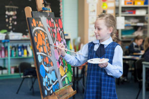 St Agnes Catholic Primary School Matraville student putting finishing touches on a painting