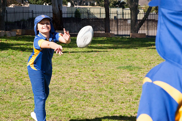 St Agnes Catholic Primary School Matraville students playing touch rugby