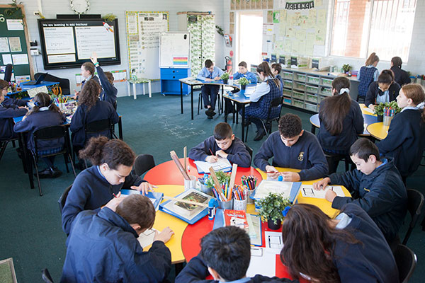 Students working in modern classroom at St Agnes Catholic Primary School Matraville