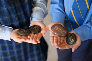 Students at St Agnes Catholic Primary School Matraville holding stones with school values