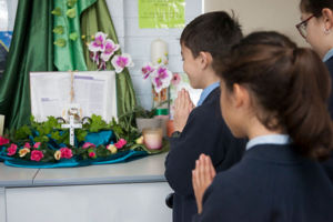 Students at St Agnes Catholic Primary School Matraville praying in a classroom