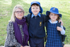 Mother and her children smiling at St Agnes Catholic Primary School Matraville