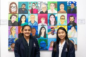 Natalia Azzi and Winnie Lay Quach with Clancy College West Hoxton collaborative Clancy Prize artwork Faces of Clancy